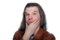 Adult man with long hair looking thoughtfully at the camera. Adult man with hand to mouth and long hair looking thoughtfully at the camera, white isolated Stock Photos