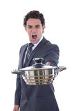 Adult man looking at pot for cooking with expression. Adult man yelling and looking at pot for cooking with expression Stock Images