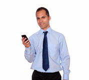 Adult man looking at you calling on cellphone Royalty Free Stock Images