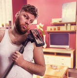 Adult man looks at the vacuum cleaner Stock Photography