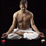 Adult man in lotus position Stock Images