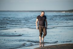 Adult man near sea, summer time stock images