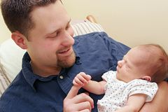 Adult man and newborn baby Royalty Free Stock Images