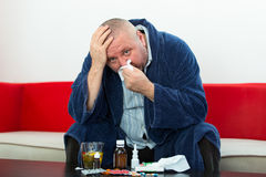 Adult man patient with cold and flu illness relief Stock Images