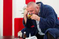 Adult man patient with cold and flu illness relief Stock Photos