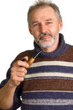 Adult man with a pipe in a hand Royalty Free Stock Image