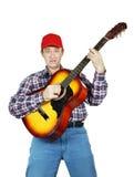 Adult man playing a guitar Stock Photo