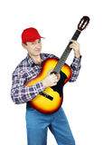 Adult man playing the guitar Royalty Free Stock Photos