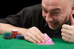 An adult man playing poker . Isolated over black Stock Photos