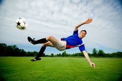 Man playing Soccer. Adult man playing soccer outdoors stock photos