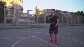 Adult man plays basketball outdoor. stock footage