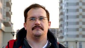 Adult man posing on urban background stock video