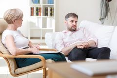 Adult man during psychotherapy session Stock Images