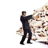 Adult man pushes a bunch of cigarette butts Stock Photo
