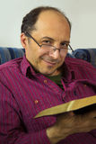 Adult man reading a bible Stock Image