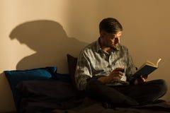 Adult man reading book Stock Photos
