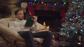 Adult man reading book in Xmas night