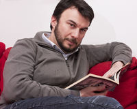 Adult Man Reading at Home Stock Images