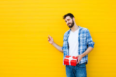 Adult man with red gift Stock Photography