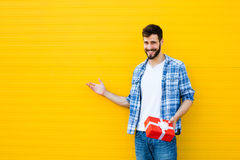 Adult man with red gift Royalty Free Stock Photo
