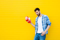 Adult man with red gift Stock Photos