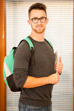 Adult man representing lifelong learning. Man with school bag sh Stock Photos