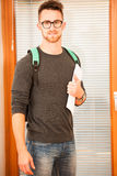 Adult man representing lifelong learning. Man with school bag sh Stock Image