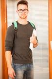 Adult man representing lifelong learning. Man with school bag sh Stock Image
