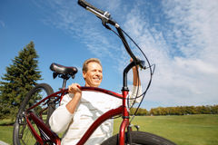 Adult man riding a bicycle Stock Photo