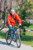 Active man riding bike in park Royalty Free Stock Photo