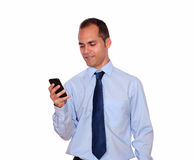 Adult man sending message by cellphone Royalty Free Stock Photos