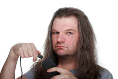 Adult man with a serious face includes a wire in the unit. Adult man with a serious face includes a wire in the unit, white isolated Royalty Free Stock Photography