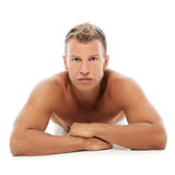 Adult man without shirt posing in studio Royalty Free Stock Photos
