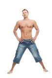 Adult man without shirt posing in studio Royalty Free Stock Images