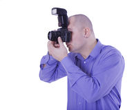 Adult man shooting with camera with flesh lamp Stock Image