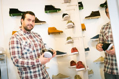 Adult Man Shopping For Shoes Royalty Free Stock Images