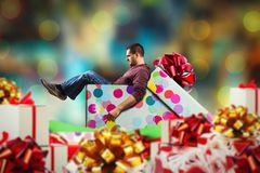 Adult man sits in present box Stock Image