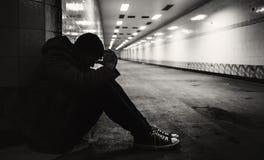 Adult Man Sitting Hopeless on The Floor Stock Photo