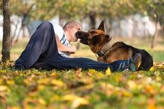 Adult Man Sitting Outdoors With His German Shepherd Stock Photos