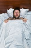 Adult man sleeps in bed Royalty Free Stock Images