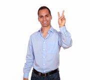 Adult man smiling and showing you victory sign Royalty Free Stock Image