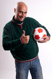 Adult man with soccer. Adult man posing with a soccerball in white background Stock Photography