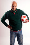 Adult man with soccer. Adult man posing with a soccerball in white background Stock Images