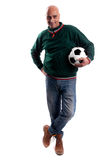Adult man with soccerball. Adult man posing with a soccerball in white background Royalty Free Stock Photo