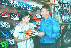 Adult man and son choosing bicycling helmet Stock Photography