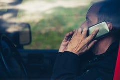 Adult man speak on smartphone in car Stock Images