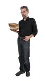 Adult man with stack of books. Adult man dressed in jeans with stack of books Royalty Free Stock Images