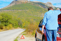 Adult man is standing near his broken car Royalty Free Stock Images