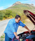 Adult man is standing near his broken car Stock Photo