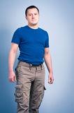 Adult man standing with a smirk face Stock Image